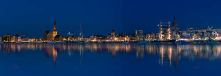 Rostock night panoramic. Warnow canal with ships and Baltic Sea in Rostock Germany in Hanse Sail Festive