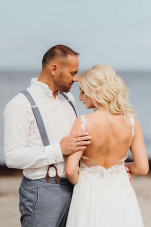 happy newly married couple on the beach. Wedding on the beach