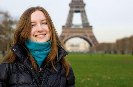 Beautiful smiling girl in Paris near the Eiffel Tower photo