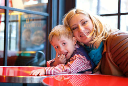 Happy mother and son in a Parisian cafe Stock Photo