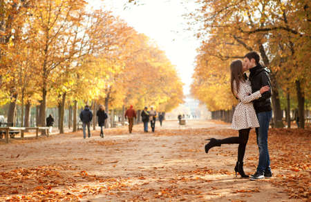 Young beautiful couple in the Luxembourg garden at fall. Paris, France Banco de Imagens