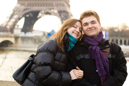 Happy couple in love in Paris near the Eiffel Tower Stock Photo - 9896525