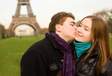 Romantic loving couple in Paris kissing near the Eiffel Tower photo