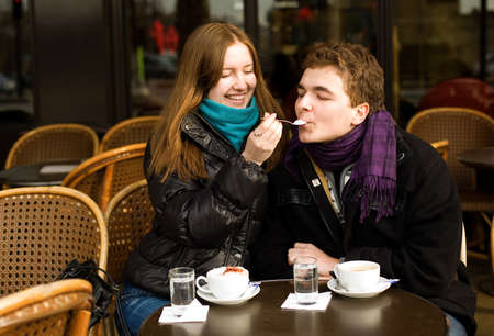 Happy romantic couple in a Parisian street cafe photo