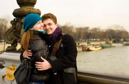 Happy loving couple in Paris hugging on the Pont Alexandre III photo