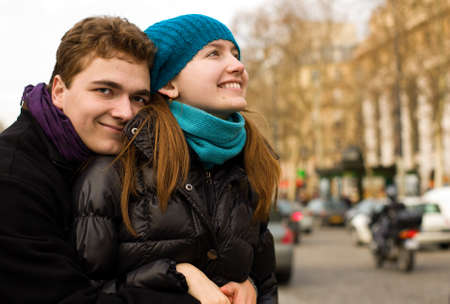 Happy loving couple in Paris, hugging on a street photo