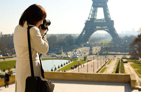 picture person: Tourist taking a picture of the Eiffel Tower in Paris