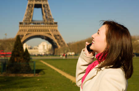 Beautiful happy woman with cell phone in Paris  photo