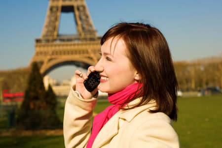 Beautiful happy woman with cell phone in Paris Stock Photo - 9896534
