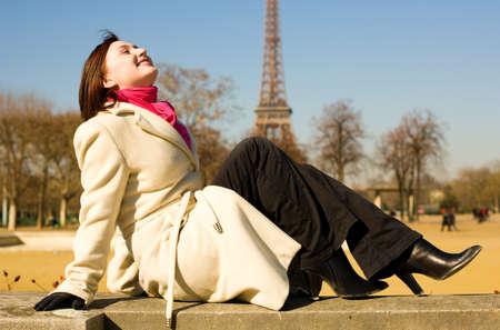 Happy beautiful woman in Paris, relaxing photo