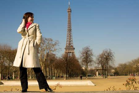 Happy beautiful woman in Paris in springtime photo