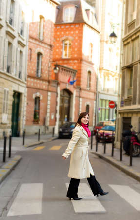 Beautiful woman in Paris, crossing a street photo