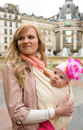 Traveling with baby. Beautiful young mother with her baby daughter in Paris photo