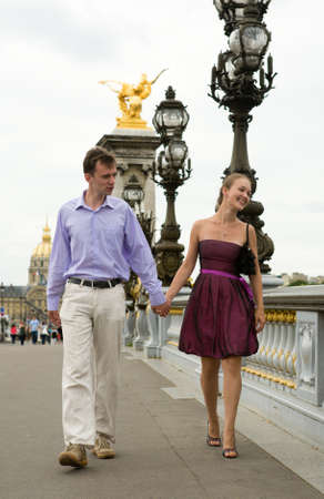 alexandre: Happy romantic couple in Paris, walking crossing the Pont Alexandre III
