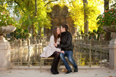Young beautiful couple in the Luxembourg garden at fall. Paris, France Banque d'images