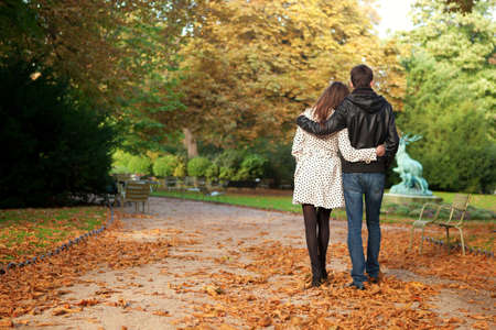 Young beautiful couple in the Luxembourg garden at fall. Paris, France Reklamní fotografie