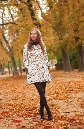 Beautiful young woman at fall photo