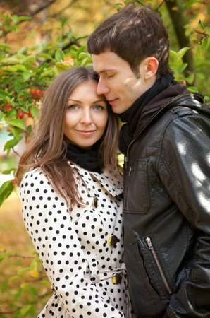 Young beautiful couple at fall photo