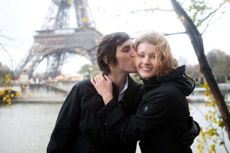 autumn in the city: Happy couple in Paris at fall