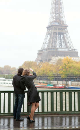 Couple in Paris at rainy weather photo