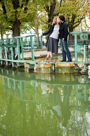 Dating couple in Paris on canal Saint-Martin photo