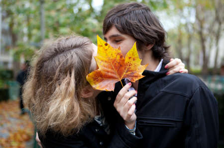 Secret kiss. Dating couple at fall Stock Photo - 9896997