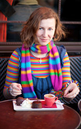 Beautiful girl in colorful clothes in a Parisian street cafe Stock Photo - 10410830