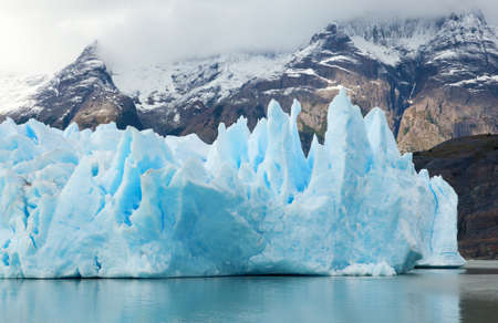 paine: Blue icebergs and snowy mountains at Grey Glacier in Torres del Paine National Park, Patagonia, Chile