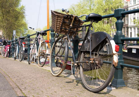 amsterdam canal: Bicycles, symbols of Amsterdam