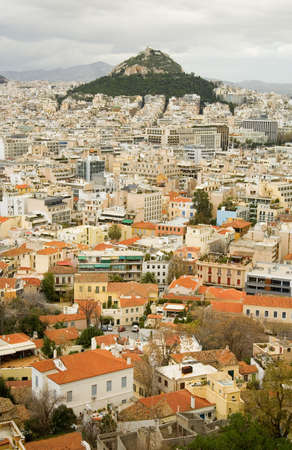 View of the Mount Lycabettus and red roofs in the center of Athens, Greece. Photo taken from Akropolis photo