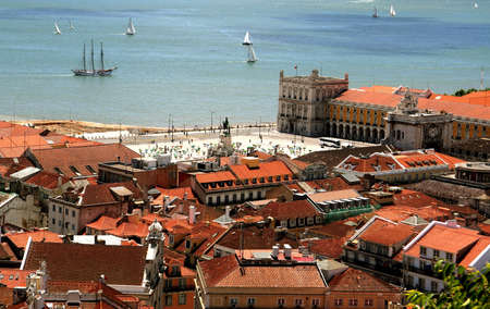 Bird way of central Lisbon with red roofs and river embankment Stock Photo