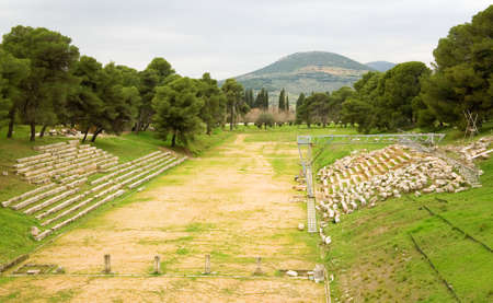 Old olympic stadium in ancient town of Epidaurus, Greece photo