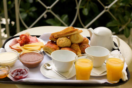 hotel balcony: Tasty breakfast for two on the balcony or in the garden