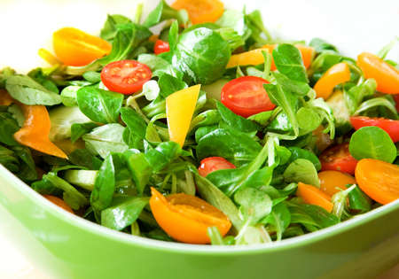 corn salad: Eat healthy! Fresh vegetable salad served in a green salad bowl Stock Photo