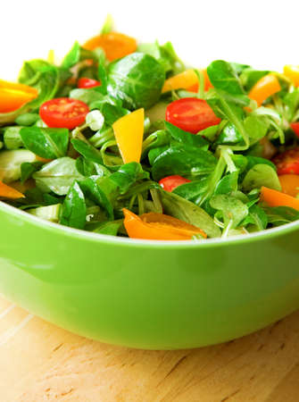 rapunzel: Eat healthy! Fresh vegetable salad served in a green salad bowl Stock Photo