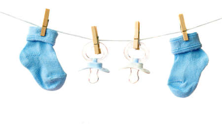 its a boy: Its a boy! Baby socks and pacifiers on the clothesline Stock Photo