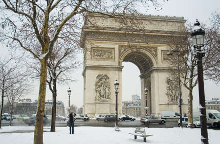 Rare snowy day in Paris. Arc de Triomphe and lots of snow photo