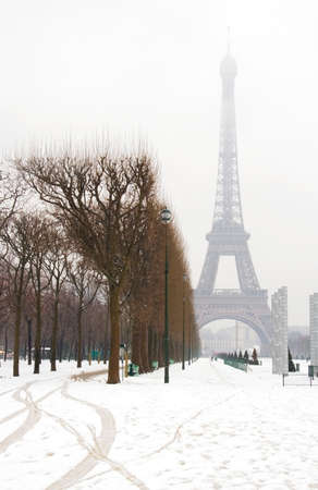 Snowy day in Paris - misty Eiffel Tower and lots of snow photo