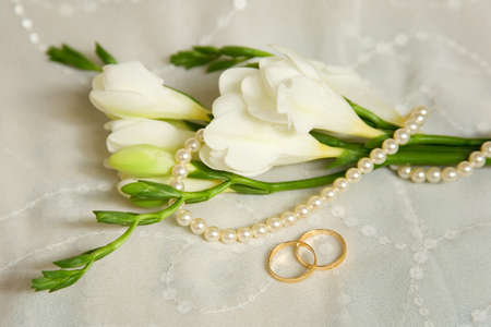 Wedding card. Two golden rings with bridal veil and flowers photo
