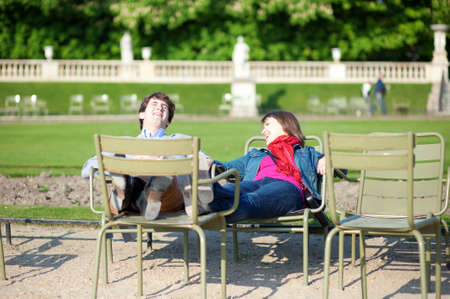 Young French couple relaxing in the Luxembourg Garden of Paris photo
