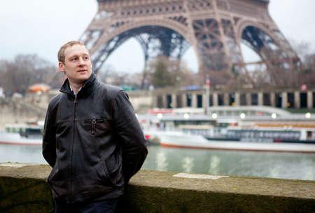 Man in Paris on the Seine embankment photo