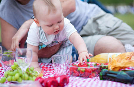 Adorable little boy on his first picnic photo