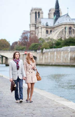 Romantic couple in Paris at the embankment photo