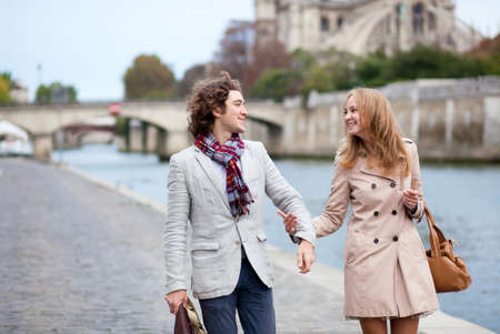 Romantic couple in Paris at the embankment Stock Photo - 10834636