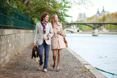 Romantic couple in Paris at the embankment photo