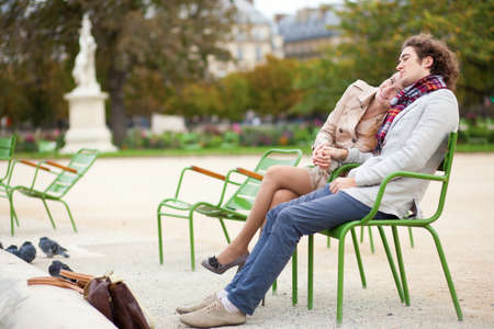 Romantic couple having a date in the Tuilleries garden of Paris photo