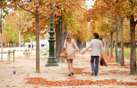 Romantic couple in Paris, having a date at fall photo