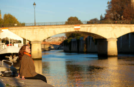 Beautiful woman relaxing at Paris embankment Stock Photo