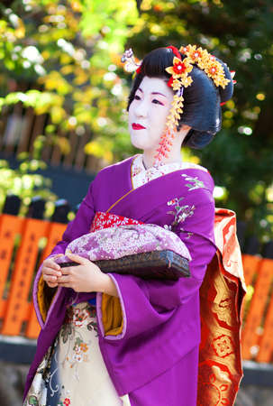 maiko: KYOTO, JAPAN - NOVEMBER 8, 2011 - Young Maiko attending the annual Kanikakni festival in Gion Editorial