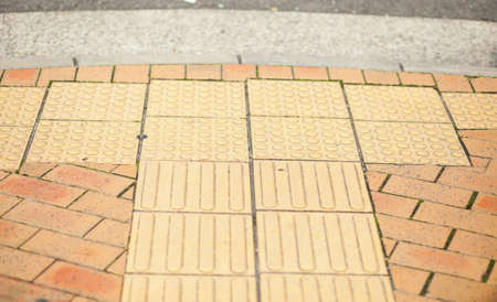 Pathway in Japan with concrete bumps for blind pedestrians Stock Photo - 11258355